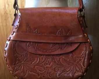 Large tooled fold-over shoulder bag