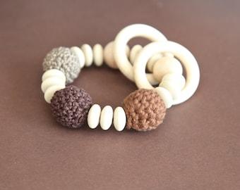 Beige and brown nursing bracelet. Teething ring rattle toy.
