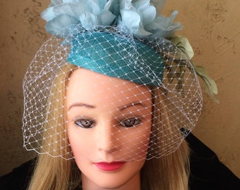 Turquoise Sinamay Fascinator and Birdcage Veiling