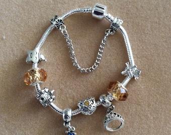 Snow White charm bracelet, silver coloured metal