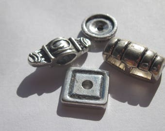 set of 4 different 12 to 20 mm (BR22) silver color metal beads