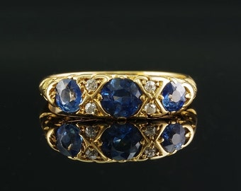 Reserved to D. A superb Edwardian  triple natural sapphire and diamond ring