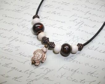 Turtle pendant leather necklace
