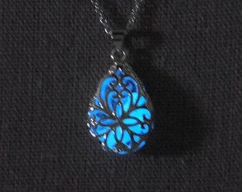 "Teardrop silver filigree pendant that glows in the dark (dark blue) on 18"" silver chain"
