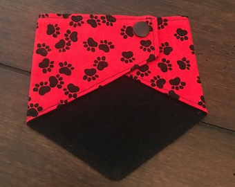 Ready to Ship. Dog bandana-red paw prints with adjustable snaps. Extra Small