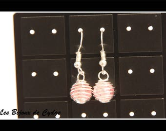 Pink earring with the bead cage