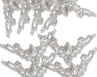 Silver tone baroque style deco corner has 4.1 cm set of 8 pieces