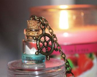 Paper boat phone charm  - BRONZE. Origami boat pendant. Bottle Charm. Glass vial pendant. Miniature bottle. Glass bottle pendant.