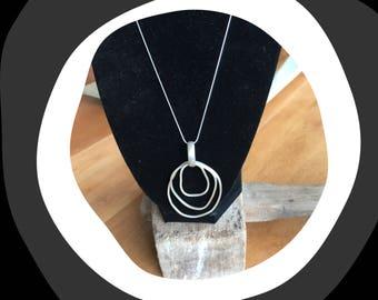 Free form silver pendant