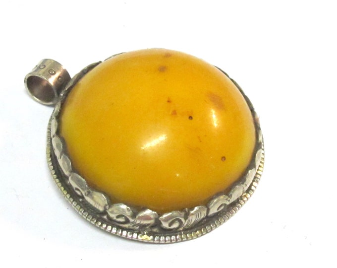Reversible Tibetan amber color copal resin pendant with reverse side lotus flower carving - PM581MN