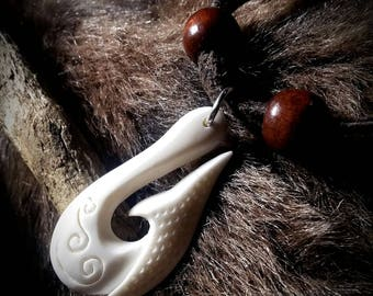 Hand Carved Buffalo Bone Leather Necklace.  Boho style from Tenbear Trading.