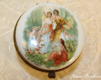 Jewel box (trinket) with a nice angel scene decorated with a garland of flowers