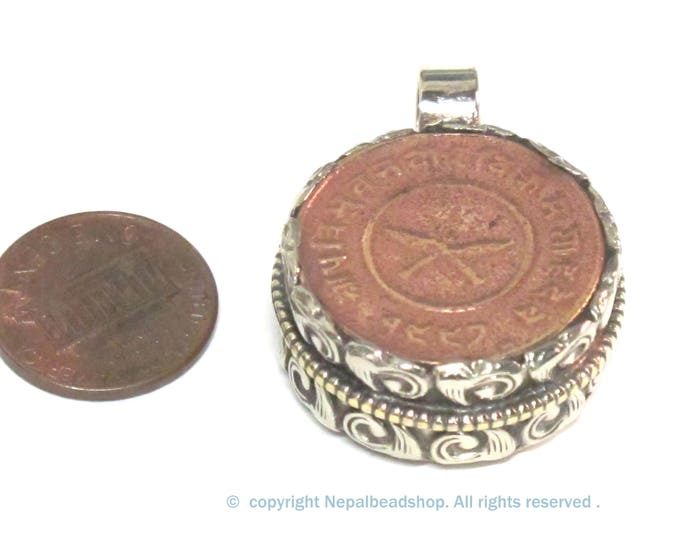 1 Pendant - Reversible Nepal copper coin pendant encased in repousse silver finish bail - PM606