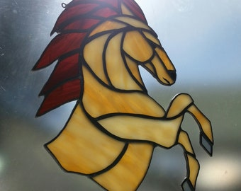 Rearing Buckskin horse