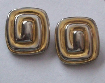 Vintage  signed GIVENCHY Paris New York Silver Gold Tone Swirl Logo Clip Earrings