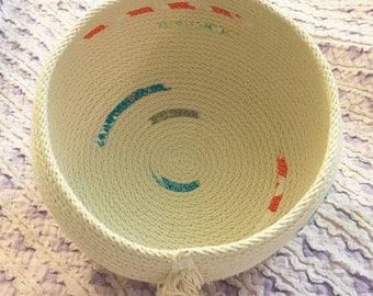 Medium sized clothesline rope bowl with turquoise fabric scraps