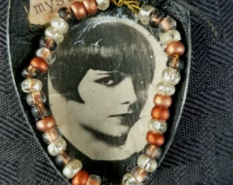 Vintage Girl Altered Spoon Necklace Mysterious  Artsy and Fun