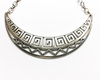 Geometric bib necklace.