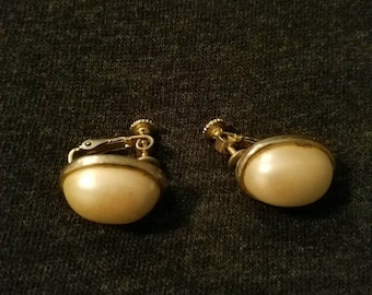 Faux pearl and gold Dauplaise clip on earrings. Signed .