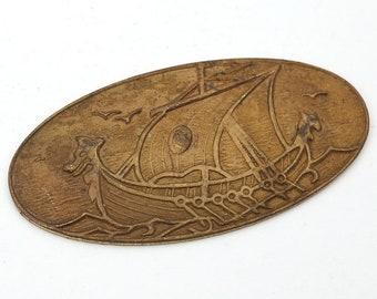Vintage dark brass Viking ship stamping, wide oval, ocean, detailed scene, 49mm x 24mm