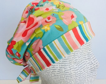 Tie Back Scrub Cap scrub hat with a light blue material with flowers in pink and green with a coordinating band 2t