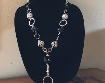 Lanyard. Beaded. Black and silver. Chain. Badge holder.