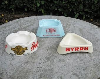Three Vintage French Pyrex  Glass  Ashtrays Named  Byrrh,- St Raphael And Floirat Autobus- Autocars