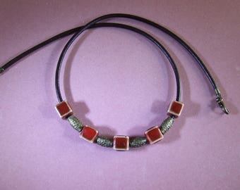Ceramic cubic beads red-orange on a mixed Brown 3 mm leather necklace