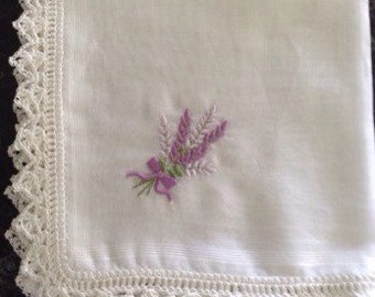 Embroidered lace handkerchief .