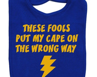 These fools put my cape on the wrong way baby bib infant toddler funny superhero shower gift -  royal blue and yellow