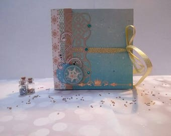 Personalized Snow Queen photo album decorated in blue, white and gold. Completely wrecked by hand it will contain up to 16 photos.