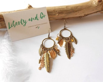 Earrings color bronze and gold with charms