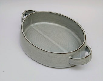 Oval stoneware serving dish with strap handles