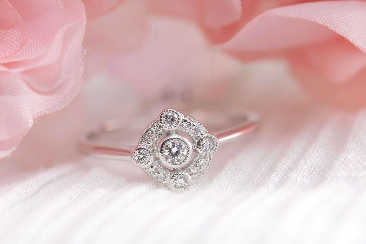 Art deco inspired diamond and white gold engagement ring /