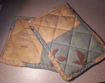 Pair of green and tan fabric trivets