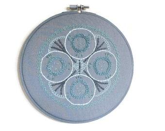Modern design hoop embroidery in grey and aqua