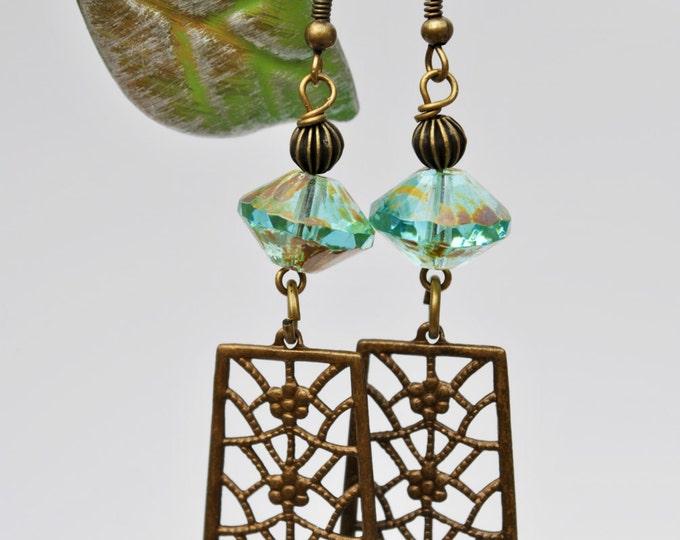 Boho earrings with brass rectangle dangles and Caribbean blue Czech glass saucer beads