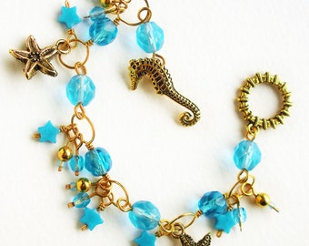 Handmade Charm Bracelet with Turquoise Blue Glass & Gold Seahorse Starfish