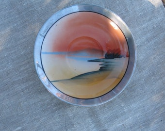 Six hand painted Japanese Plates