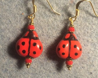 Red and black ceramic ladybug bead earrings adorned with red Chinese crystal beads.
