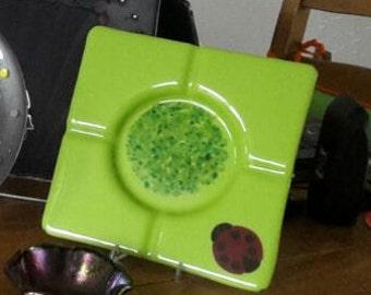 green glass dish/ashtray with Ladybug
