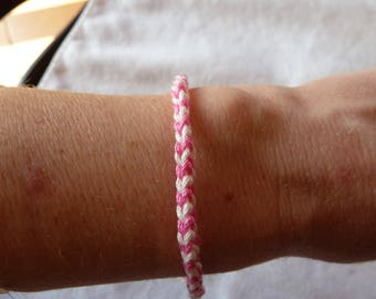 Fine white and pink cotton crocheted, lucky bracelet is handmade