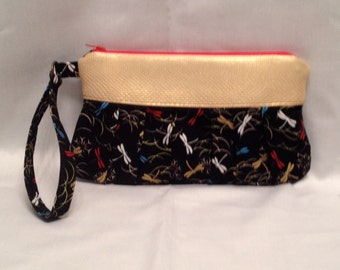 AK6- Compleat Clutch: in a lovely dragonfly print with pleated front, zipper closure and detatchable hand strap