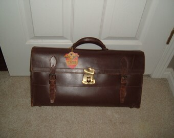 Vintage 50's McBrine Baggage sachel.  Key included.  Chestnut brown, 17 1/2 x 9 1/2 in x 4 1/2.   Only wear is on straps.