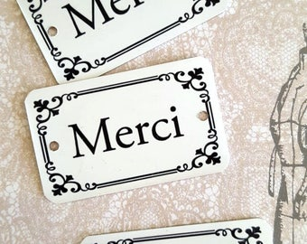 """Merci"" metal plate"