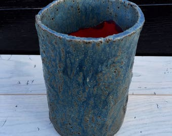 Blue and red vase with glaze