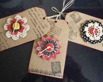 hand-made 3 tags on cardstock with 3 different flowers