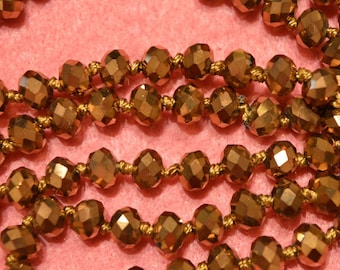 Set of 20 Crystal beads has gold facet
