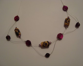 Purple and beige color necklace