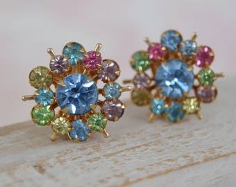 Vintage Clip-On Earrings in Gold-Tone Metal and Starburst Rhinestone Design